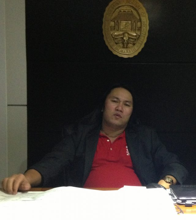 rey-galua-at-office-
